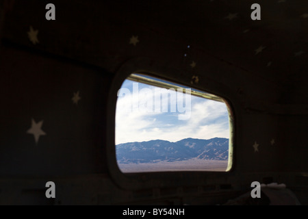Mountains in Death Valley framed by window of Manson family member 'Tex' Watson's 1942 Dodge Power Wagon in Ballarat - Stock Photo