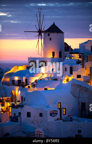 Oia ( Ia ) Santorini - Windmills and town at sunset, Greek Cyclades islands - Photos, pictures and images - Stock Photo