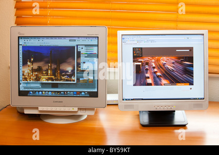 Computer monitors using energy. - Stock Photo
