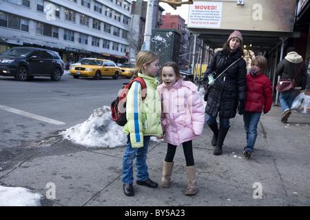 Children going home after school, Manhattan, New York City. - Stock Photo