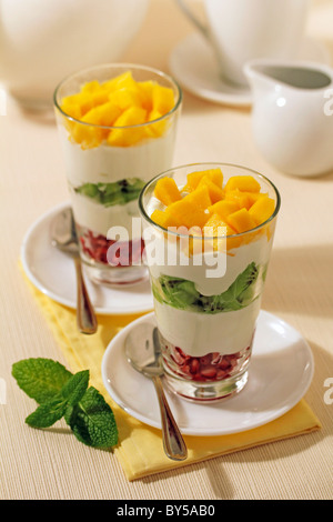 Yogurt with tropical fruits. Recipe available. - Stock Photo