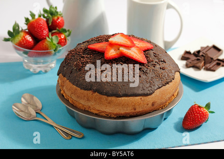 Big pastry with chocolate and strawberries. Recipe available - Stock Photo