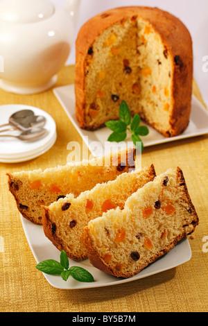 Panettone with orange and raisins. Recipe available. - Stock Photo