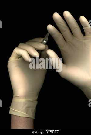 A man wearing a surgical gloves and holding a scalpel, directly below, hands only - Stock Photo