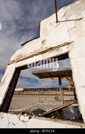 Abandoned Union 76 service station along Highway 62 with view of a train in the distance in the ghost town of Rice, - Stock Photo