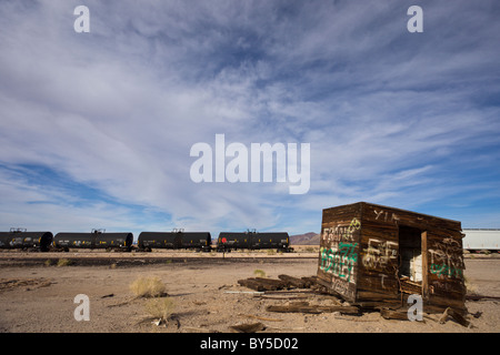 Abandoned depot with train and tracks along Highway 62 in the ghost town of Rice, California, USA. - Stock Photo