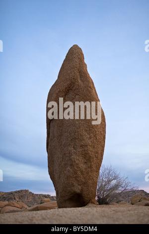 Large granite monolith at dusk in the Jumbo Rocks campground. Joshua Tree National Park, California, USA. - Stock Photo