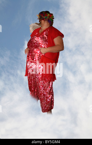Cupid  emerging from the clouds - Stock Photo