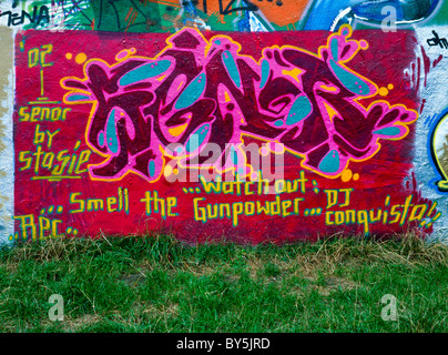 A wall covered in graffiti art - Stock Photo