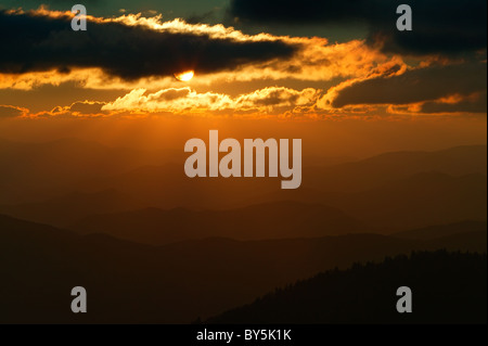 Sun rays and orange sky at sunset viewed from Clingman's Dome in Great Smoky Mountains National Park. - Stock Photo