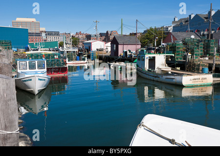 Commercial fishing wharf with lobster traps and lobster for Portland maine fishing