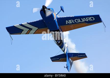 John Klatt flies inverted in his custom built Staudacher S-300D - Stock Photo