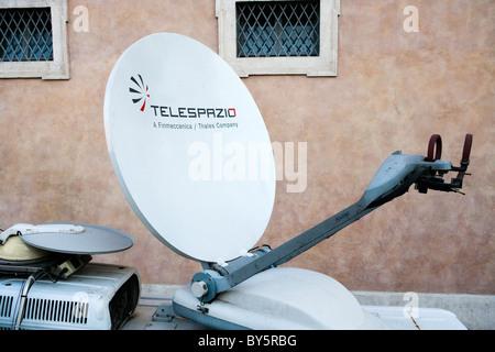 broadcast dish live outside satellite sat mounted on van television tv Italy Rome Italian - Stock Photo