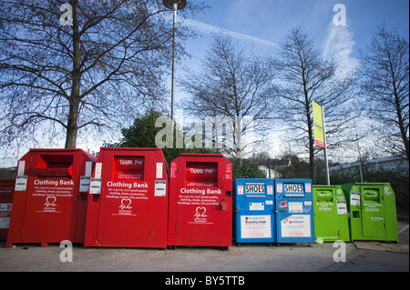 Mixture of recycling bins in a Supermarket car park - Stock Photo