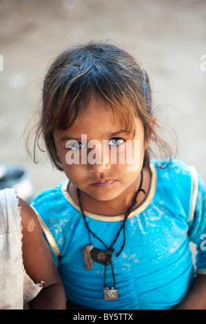 Young poor lower caste Indian street girl from Utter Pradesh looking up - Stock Photo