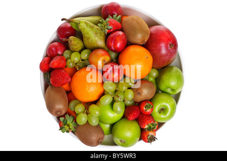 Photo of a bowl of fresh fruit isolated on a white background, shot from above. - Stock Photo