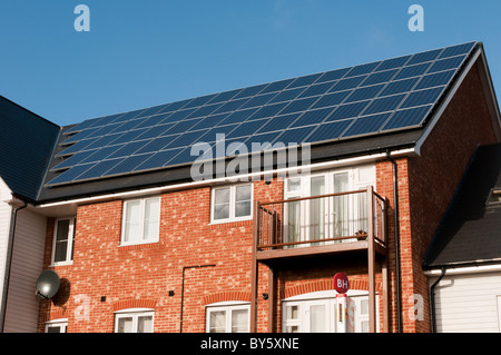 A renewable energy supply in the form of photovoltaic panels on the roof of a new development in Bromley, Kent, - Stock Photo