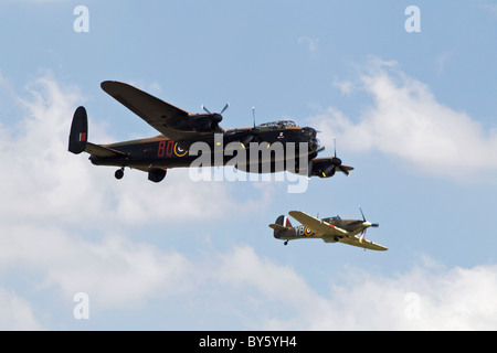 An Avro Lancaster and Hawker Hurricane of the Battle of Britain Memorial flight in close formation - Stock Photo