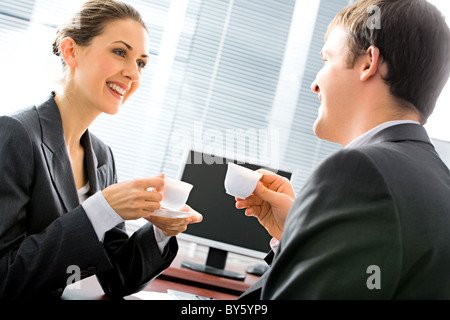 Portrait of business partners drinking coffee in the morning