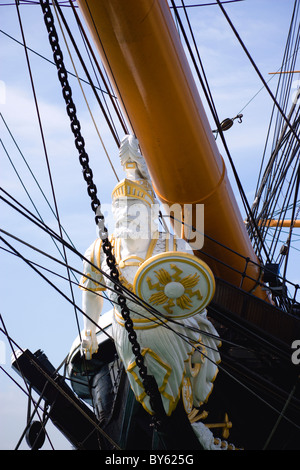 England Hampshire Portsmouth Harbour Historic Naval Dockyard Ship's figurehead of HMS Warrior first iron hulled - Stock Photo