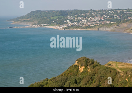 Looking east to Lyme Regis on the Dorset coast, viewed from Cains Folly cliffs - Stock Photo