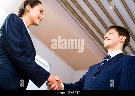 Business handshake meaning a successful bargain of two partners - Stock Photo