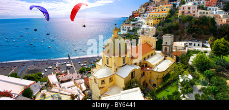 Paraglider over Positano town - Amalfi caost - Italy - Stock Photo