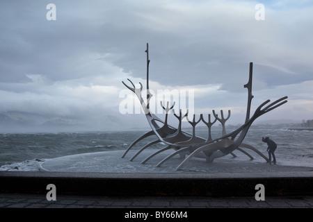 Sólfar, a sculpture in Reykjavík, Iceland, during a January storm. - Stock Photo