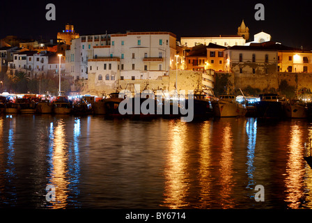 Old town of Termoli with it's harbor by night - Stock Photo