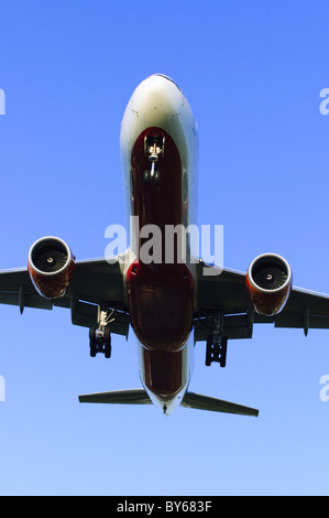 Low flying Boeing 777 operated by Air India on final approach for landing at London Heathrow Airport - Stock Photo