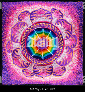 Multicoloured Hindu OM / AUM and lotus flower embroidery pattern. Indian handicraft - Stock Photo