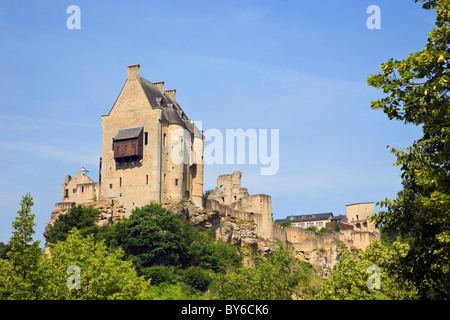 Larochette, Grand Duchy of Luxembourg, Europe. Maison de Crehange medieval castle ruins on a rock outcrop high above - Stock Photo