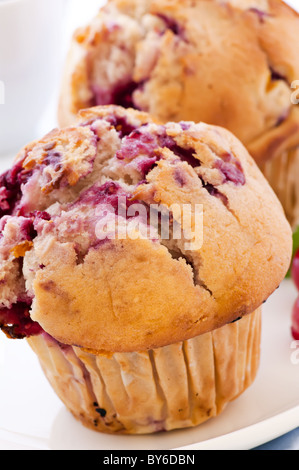 Raspberry muffin as closeup on white background - Stock Photo