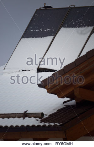 Solar panels covered with snow - Bavaria Germany - Stock Photo
