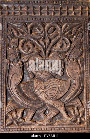 Famous ancient wood carvings at Embekke Temple near Kandy SriLanka - Stock Photo