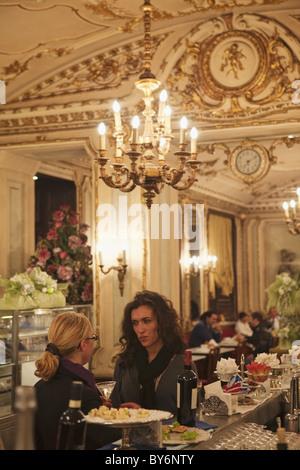 Two women having a conversation in Cafe Platti, Turin, Piedmont, Italy - Stock Photo