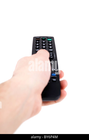 Hand holding television remote Isolated over white background .