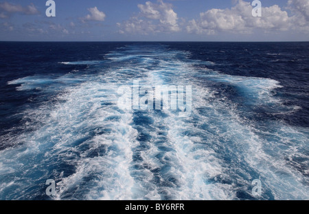 The beautiful blue wake of a cruise ship in the Atlantic. - Stock Photo