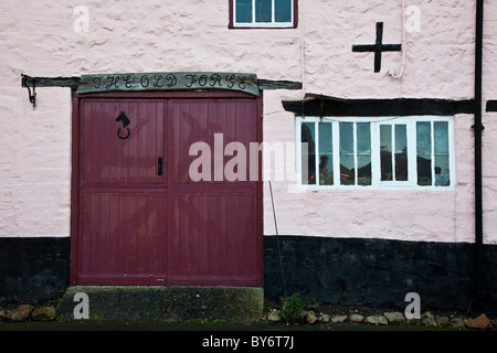 Converted old forge now used as a house in the typical English village of Aldbourne, Wiltshire, England,UK - Stock Photo