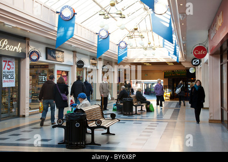 Small indoor shopping mall in the typical English provincial country town of Trowbridge, Wiltshire, England, UK - Stock Photo
