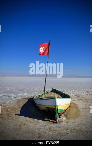 Rowing boat on Chott-el-Jerid salt flats in Tunisia - Stock Photo