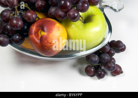 Bowl of fresh fruit with grapes, apples, nectarine - Stock Photo