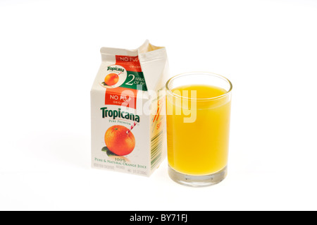Poured glass of Tropicana orange juice with open carton on white background, cutout. - Stock Photo
