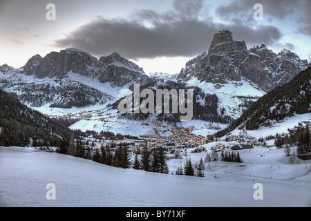 View over Corvara with mount Sassongher in the evening, Alta Badia, Dolomites, Trentino-Alto Adige/Suedtirol, Italy - Stock Photo