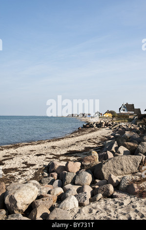 Houses on the beach of Graswarder peninsula, Heiligenhafen, Schleswig-Holstein, Germany - Stock Photo