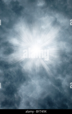 Godly rays shining through gray clouds - Stock Photo