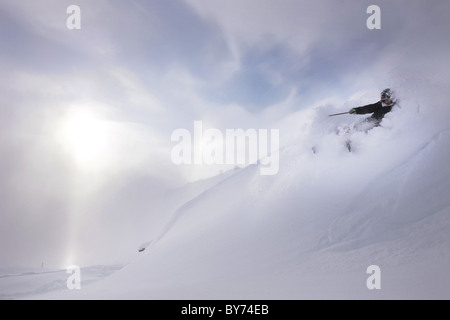 Male free skier in deep snow, Mayrhofen, Ziller river valley, Tyrol, Austria - Stock Photo