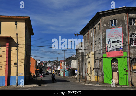 Urban street scene, '1900 Cafe' block, shops electricity cables, E.Ramirez crossing Blanca Encalada, Ancud, Chiloe - Stock Photo
