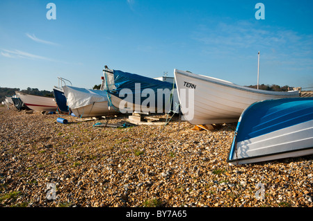 Wooden Fishing Boats On A Shingle Beach Pett Level East Sussex England - Stock Photo