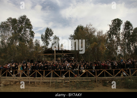 Christian pilgrims taking part in the Epiphany ceremony in the baptismal site Al-Maghtas officially known as Bethany - Stock Photo